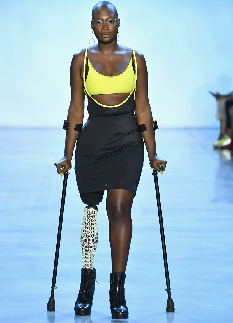 Mama Cax walks the runway using crutches as her right leg was amputated